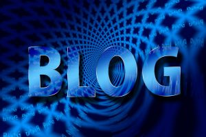 Blog in big blue letters